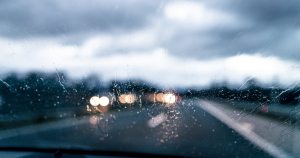 A common cause of auto collisions - the view looking out blurry windshield during storm